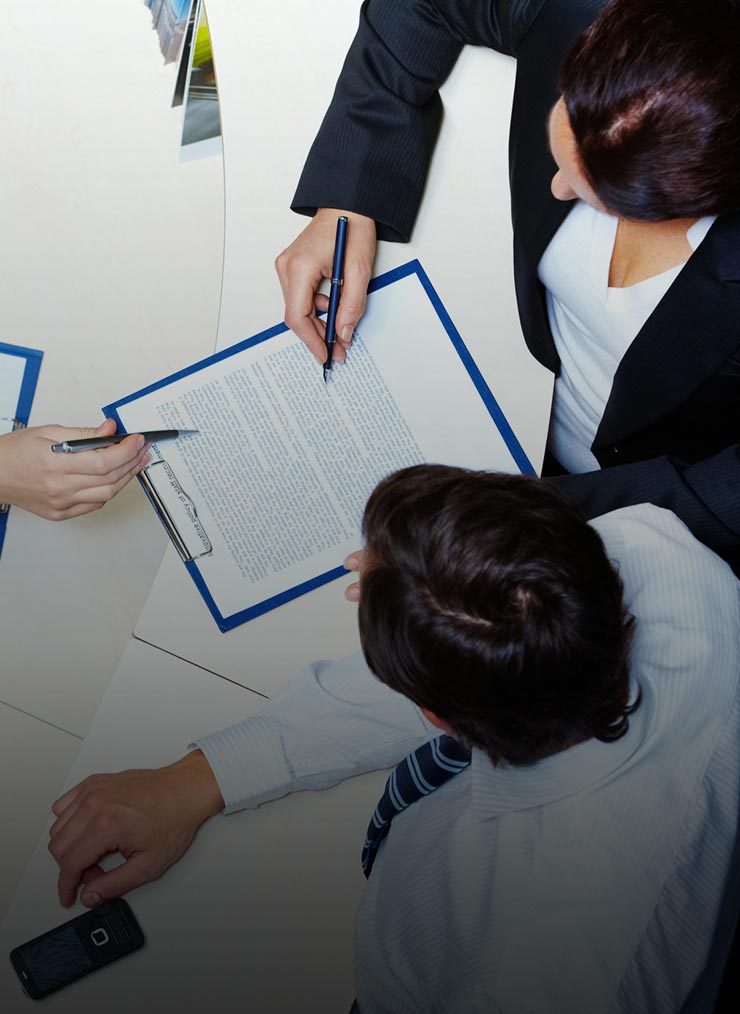 People reviewing contracts